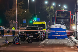 © Licensed to London News Pictures. 21/07/2021. London, UK. A forensic tent sits in front of a London bus at the scene following a fatal stabbing on Brixton Road, Brixton. Metropolitan Police Service (MPS) were called at 20:18BST to reports of an assault close to Brixton Underground Station. Despite efforts from police officers, paramedics from London Ambulance Service (LAS) and London's Air Ambulance the man was pronounced dead at the scene at the 20:45BST. Photo credit: Peter Manning/LNP