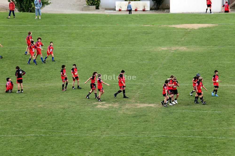 children preparing on the field for soccer game