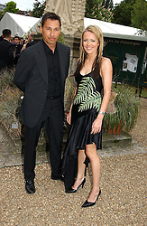 NATHAM MOORE and HAYLEY EVETTS at a fund raising event for The Galapagos Conservation Trust entitled 'Some Enchanted Evening' at the Chelsea Physic Garden Chelsea, London on 17th June 2004.