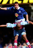 Gerry Taggart (Leicester City) Dion Dublin (Aston Villa). Leicester City v Aston Villa, 19/8/2000, F.A. Carling Premiership. Credit : Colorsport / Matthew Impey.