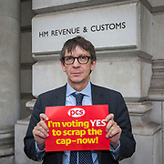Craig Mason, HMRC, 100 Parliament Street. PCS members working in the civil service are holding a short, high profile protest to demonstrate about the continued 1% pay cap public sector pay cap that has been in place for 7 years.Westminster,  London,  United Kingdom. (Photo by Andy Aitchison / PCS)