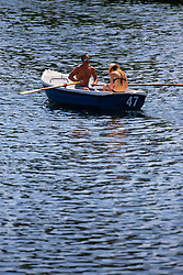 A couple relax on a boat on The Serpentine in Hyde Park as another heatwave day begins with temperatures expected to soar. London, July 01 2018.