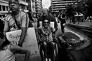 """Athens, Greece - Demonstration of cancer patients and disabled people against the cuts to the Health system. Greek economical crisis started in 2008. The so-called Austerity measures imposed to the country by the """"Troika"""" (European Union, European Central Bank, and International Monetary Fund) to reduce its debt, were followed by a deep recession and the worsening of life conditions for millions of people. Unemployment rate grew from 8.5% in 2008 to 25% in 2012 (source: Hellenic Statistical Authority). <br /> Bruno Simões Castanheira"""