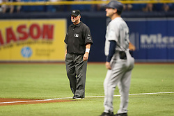 August 19, 2017 - St. Petersburg, Florida, U.S. - WILL VRAGOVIC   |   Times.Umpire Dana DeMuth (32) off second base during the game between the Seattle Mariners and the Tampa Bay Rays at Tropicana Field in St. Petersburg, Fla. on Saturday, Aug. 19, 2017. The World Umpires Association announced that umpires will be wearing white wristbands during all games to protest escalating verbal attacks on umpires and their strong objection to the Office of the Commissioner's response to the attacks. (Credit Image: © Will Vragovic/Tampa Bay Times via ZUMA Wire)