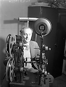 "21/09/1960<br /> 09/21/1960<br /> 21 September 1960<br /> Editing ""Mise Eire"". Mr George Morrison, director and compiler of the film at work editing the second half of the film at Peter Hunt Studio, Dublin."