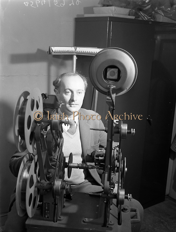"""21/09/1960<br /> 09/21/1960<br /> 21 September 1960<br /> Editing """"Mise Eire"""". Mr George Morrison, director and compiler of the film at work editing the second half of the film at Peter Hunt Studio, Dublin."""