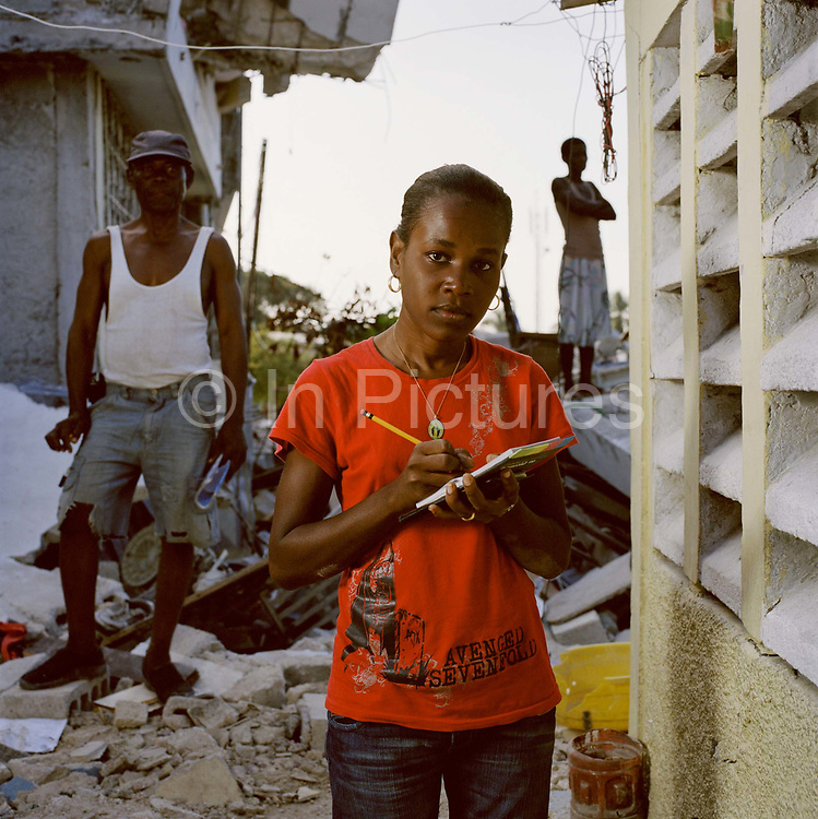"""Sharline  Dagou, 24, was a secretary at a restaurant in Petion-Ville, she poses with her mother and brother outside her house. """"I was in my bedroom with my family when the quake struck. """"The first shock was smaller like a preview of the next one. The door was blocked, but we pushed and got out but my younger brother was caught. When we came out we saw our houses destroyed. Now we have nothing. I even lost my shoes and  have been barefoot for the last three weeks.  Most of the families who lost people have left, they cannot bare to stay. We pray to cope with our sadness. A Dominican missionary came to give us courage, he told us we have to accept because we love God. """"I often cry, but I still smile as well. We have to, we have to hope for the future. Where there is life there is hope."""""""