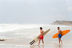 two male surfers going into the ocean in Montauk, NY