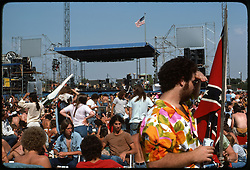 The crowd, deadheads, relaxing before the Grateful Dead Concert begins at Roosevelt Stadium 4 August 1976. POV of the stage from the Photographs home base for the duration of the show.