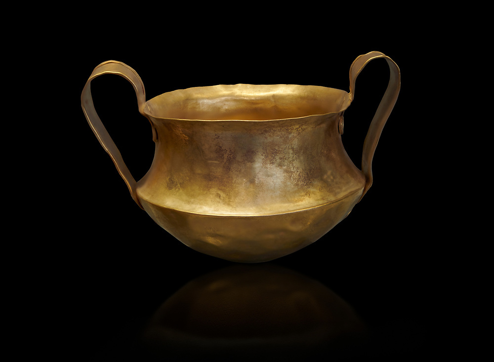 Two handled Mycenaean gold bowl cup from the Kakovatos tholos tomb, Trifylia, Greece. National Archaeological Museum Athens. Black Backgroundb<br /> <br /> Kakovatos is a significant site of the early Mycenaean period of Greece (c. 16th to 15th century BC) on the west coast of the Peloponnese (Zacharo, Nomos Elis) and became widely known through the excavations of three large tholos tombs by Wilhelm Dörpfeld in 1907–1908. .<br /> <br /> If you prefer to buy from our ALAMY PHOTO LIBRARY  Collection visit : https://www.alamy.com/portfolio/paul-williams-funkystock/mycenaean-art-artefacts.html . Type -   Athens    - into the LOWER SEARCH WITHIN GALLERY box. Refine search by adding background colour, place, museum etc<br /> <br /> Visit our MYCENAEN ART PHOTO COLLECTIONS for more photos to download  as wall art prints https://funkystock.photoshelter.com/gallery-collection/Pictures-Images-of-Ancient-Mycenaean-Art-Artefacts-Archaeology-Sites/C0000xRC5WLQcbhQ