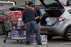 © Licensed to London News Pictures. 1/11/2020. Sheffield, UK.  Couple load toilet rolls in their car after shopping at Costco in Sheffield, South Yorkshire. . British Prime Minister Boris Johnson announced a new four week lockdown across England, from Thursday 5 November, to contain the spread of covid-19.  Photo credit: Ioannis Alexopoulos/LNP
