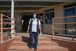 Abrey Arendse, Operational Manager at De Doorns Clinic, a Western Cape government facility, where the staff has painted social-distancing lines on the ground, Wednesday May 6, 2020. Each morning, hundreds of patients line up here, says Arendse. She personally greets everyone to see who needs to come inside the clinic right away, including the elderly, very sick, pregnant ladies and disabled people. The COVID-19 pandemic is a challenge, she says. There is not enough PPE on hand for patients and no long-term stock for staff. It's also difficult to leave patients waiting outside. The sun is strong, and the winter rains are coming. De Doorns is a town in the Breede Valley Local Municipality, Cape Winelands District Municipality, in the Western Cape province of South Africa. PHOTO: EVA-LOTTA JANSSON
