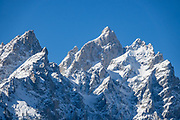 Snow-covered Teewinot Mountain (on left 12,325 feet) and Grand Teton (center 13,775 ft) in Grand Teton National Park, Wyoming, USA.