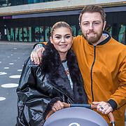 NLD/Amsterdam/20190228 - Opening Holland Zingt Hazes 2019 Backstage Cafe, Roxanne Hazes en partner Erik Zwennes achter de kinderwagen van baby Fender