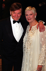 "Actress Dame Judi Dench, (who plays ""M""), and her husband actor Michael Williams arrive at the European Charity Premiere of ""The World Is Not Enough"", which stars Pierce Brosnan as James Bond, at the Odeon Leicester Square, London.  *  25/11/2000:  Actor Michael Williams has received a Papal knighthood for his contribution to Catholic life in Britain.  Williams, who played alongside his wife in TV's A Fine Romance, has been appointed a Knight of St Gregory, one of the highest honours conferred by the Catholic Church."