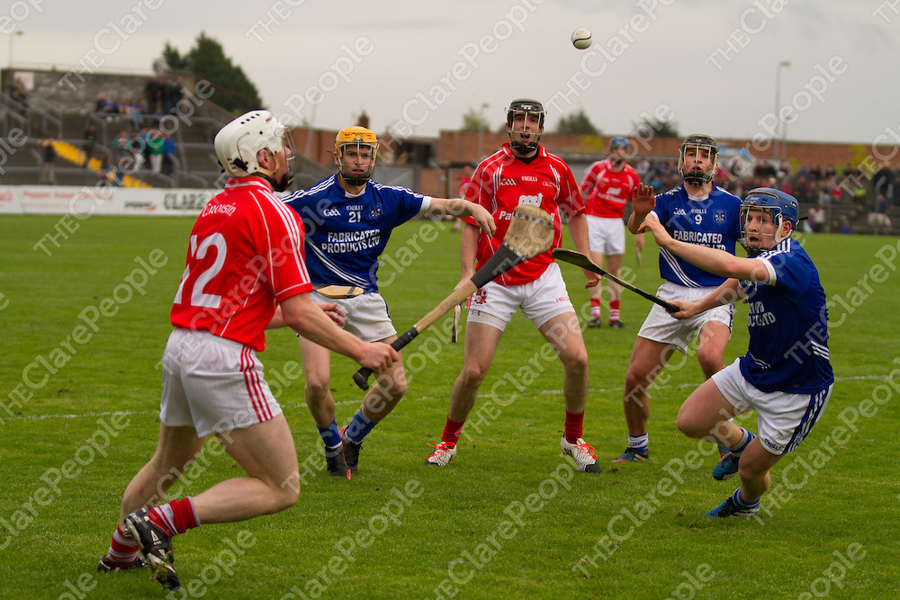 Cratloe's Padraic Collins and Crusheen's Alan Tuohy both go for the slíotar
