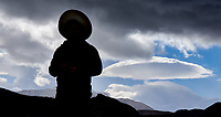 Silhouette and lenticular clouds in Patagonia. Image taken with a Fuji X-T1 camera and 55-200 mm lens (ISO 200, 55 mm, f/11, 1/250 sec).