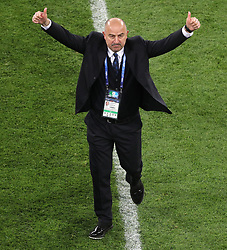 Russia manager Stanislav Cherchesov celebrates victory after the FIFA World Cup 2018, Group A match at Saint Petersburg Stadium.