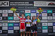 Women Elite Cross Country podium: 2nd, Annika Langvad (DEN); 1st Kate Courtney (USA); 3rd Emily Batty (CAN) at the 2018 UCI MTB World Championships - Lenzerheide, Switzerland