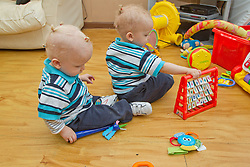 Twin boys playing. (This photo has extra clearance covering Homelessness, Mental Health Issues, Bullying, Education and Exclusion, as well as the usual clearance for Fostering & Adoption and general Social Services contexts,)