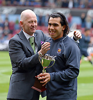 Photo: Ed Godden/Sportsbeat Images.<br /> West Ham United v Bolton Wanderers. The Barclays Premiership. 05/05/2007. West Ham Chairman Eggert Magnusson (L) presents the West Ham Player of The Year Award to Carlos Tevez.
