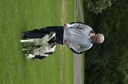 Eddie Sander with his Dogs Jackson and Inka<br /><br />18 June 2004<br /><br />Copyright Paul David Drabble<br /> [#Beginning of Shooting Data Section]<br />Nikon D1 <br /> Focal Length: 80mm<br /> Optimize Image: <br /> Color Mode: <br /> Noise Reduction: <br /> 2004/06/18 09:40:09.6<br /> Exposure Mode: Manual<br /> White Balance: Auto<br /> Tone Comp: Normal<br /> JPEG (8-bit) Fine<br /> Metering Mode: Center-Weighted<br /> AF Mode: AF-S<br /> Hue Adjustment: <br /> Image Size:  2000 x 1312<br /> 1/200 sec - F/7.1<br /> Flash Sync Mode: Not Attached<br /> Saturation: <br /> Color<br /> Exposure Comp.: 0 EV<br /> Sharpening: Normal<br /> Lens: 80-200mm F/2.8<br /> Sensitivity: ISO 200<br /> Image Comment: <br /> [#End of Shooting Data Section]