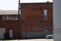 09 June 2012:   The words Dry Goods still appear on a vintage brick store building in downtown McLean Illinois.