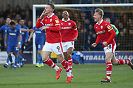 Barnsley attacker Cauley Woodrow (9) celebrating after scoring goal to make it 0-1 during the EFL Sky Bet League 1 match between AFC Wimbledon and Barnsley at the Cherry Red Records Stadium, Kingston, England on 19 January 2019.