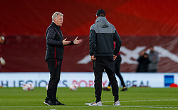 LIVERPOOL, ENGLAND - Saturday, October 31, 2020: West Ham United's manager David Moyes (L) chats with Liverpool's manager Jürgen Klopp before the FA Premier League match between Liverpool FC and West Ham United FC at Anfield. The game was played behind closed doors due to the UK government's social distancing laws during the Coronavirus COVID-19 Pandemic. (Pic by Propaganda)