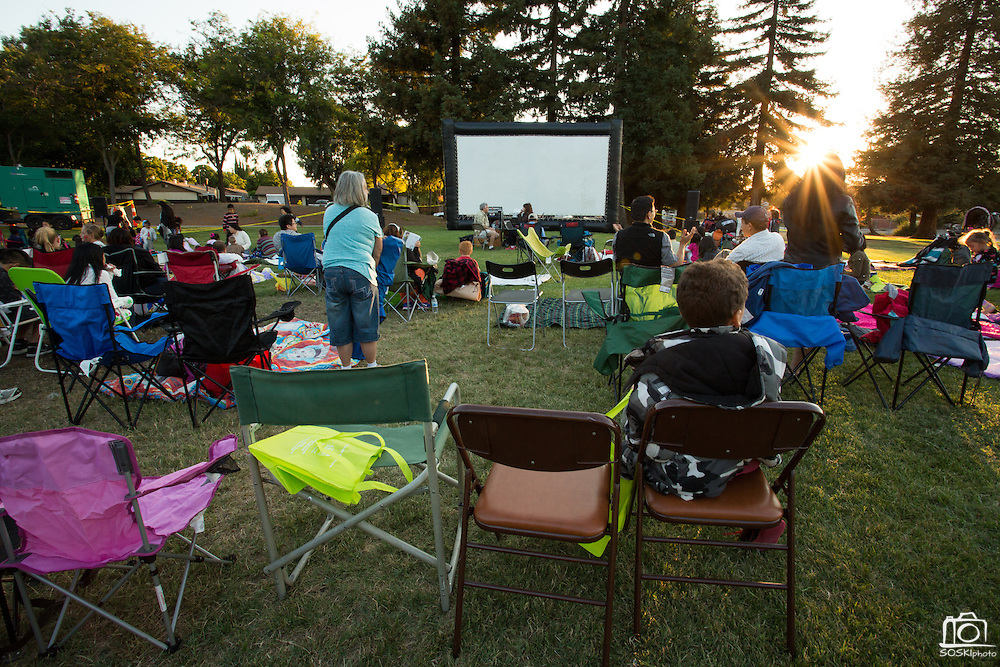 Hundreds of families set up chairs and blankets to watch Brave during the 6th Annual District 4 National Night Out Resource Fair and Movie Night at Northwood Park in San Jose, California, on August 6, 2013. (Stan Olszewski/SOSKIphoto)