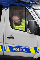 © Licensed to London News Pictures . 21/03/2014 . Preston , UK . A policeman in a police van adjacent to the demonstration camp with his eyes closed and his head propped up against the van's window , during a quiet moment at the protest site . The Barton Moss anti-fracking demonstration camp today (Friday 21st March 2014) . Photo credit : Joel Goodman/LNP