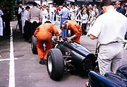 Graham Hill BRM P261 racing car mechanics working, Belgian Grand Prix 1964, Spa, Belgium, Raymond Mays in the background