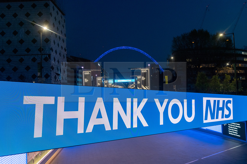 © Licensed to London News Pictures. 09/04/2020. London, UK. Wembley Stadium is lit blue to honour the efforts of National Health Service workers fighting the Coronavirus outbreak. The country is currently in lockdown to minimise the spread of COVID-19. Photo credit: Ray Tang/LNP