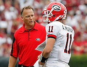 COLUMBIA - SEPTEMBER 11:  Head coach Mark Richt of the Georgia Bulldogs speaks with quarterback Aaron Murray #11 during the game against the South Carolina Gamecocks at Williams-Brice Stadium on September 11, 2010 in Columbia, South Carolina.  The Gamecocks beat the Bulldogs 17-6.  (Photo by Mike Zarrilli/Getty Images)