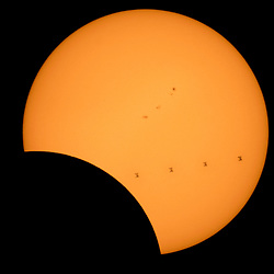 This composite image, made from 4 frames, shows the International Space Station, with a crew of six onboard, as it transits the Sun at roughly five miles per second during a partial solar eclipse, Monday, Aug. 21, 2017 from , Northern Cascades National Park in Washington. Onboard as part of Expedition 52 are: NASA astronauts Peggy Whitson, Jack Fischer, and Randy Bresnik; Russian cosmonauts Fyodor Yurchikhin and Sergey Ryazanskiy; and ESA (European Space Agency) astronaut Paolo Nespoli. A total solar eclipse swept across a narrow portion of the contiguous United States from Lincoln Beach, Oregon to Charleston, South Carolina. A partial solar eclipse was visible across the entire North American continent along with parts of South America, Africa, and Europe.  Photo Credit: (NASA/Bill Ingalls)  Please note: Fees charged by the agency are for the agency's services only, and do not, nor are they intended to, convey to the user any ownership of Copyright or License in the material. The agency does not claim any ownership including but not limited to Copyright or License in the attached material. By publishing this material you expressly agree to indemnify and to hold the agency and its directors, shareholders and employees harmless from any loss, claims, damages, demands, expenses (including legal fees), or any causes of action or allegation against the agency arising out of or connected in any way with publication of the material.