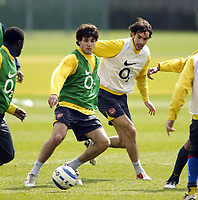 Photo: Chris Ratcliffe.<br />Arsenal Training Session. UEFA Champions League. 18/04/2006.<br />Cesc Fabregas is closed down by Robert Pires during training