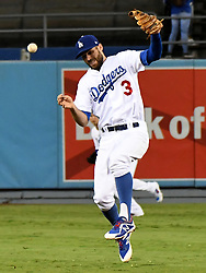 September 7, 2017 - Los Angeles, California, U.S. - Los Angeles Dodgers shortstop Chris Taylor commits a error as Colorado Rockies' DJ LeMahieu (not pictured) is safe at first base in the second inning of a Major League baseball game at Dodger Stadium on Thursday, Sept. 07, 2017 in Los Angeles. (Photo by Keith Birmingham, Pasadena Star-News/SCNG) (Credit Image: © San Gabriel Valley Tribune via ZUMA Wire)