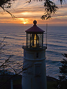 Heceta Head Lighthouse at sunset in winter, on the Oregon coast.. Heceta Head Lighthouse may be the most photographed beacon in the United States. Built in 1893, it was named for the Spanish mariner who is credited with being the first European to set foot in the region. The light at top of 56-foot tower was first illuminated in 1894. Perched 205 feet above the ocean, its fresnel lens beams the brightest light on the Oregon coast, visible up to 21 miles out to sea.  Location: Halfway between Cape Perpetua and Florence, a turnoff just south of Carl Washburne State Park (which has a great campground) takes you to the parking lot on a beach, where you can walk a half mile to the lighthouse. Heceta Head State Park includes Devils Elbow State Park and is located in a scenic cove at the mouth of Cape Creek.