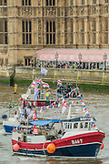 Boats pass the crowded bars on the Terrace of Parliament - Nigel Farage, the leader of Ukip, joins a flotilla of fishing trawlers up the Thames to Parliament to call for the UK's withdrawal from the EU, in a protest timed to coincide with prime minister's questions.