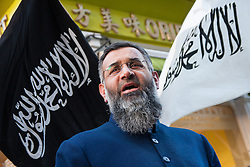 London, 22 November 2013. Radical Islamist preacher Anjem Choudary speaks as his Islam4UK holds a protest and leafleting outreach to the public in Chinatown to highlight the persecution of Muslims in China. ///FOR LICENCING CONTACT: paul@pauldaveycreative.co.uk TEL:+44 (0) 7966 016 296 or +44 (0) 20 8969 6875. ©2015 Paul R Davey. All rights reserved.