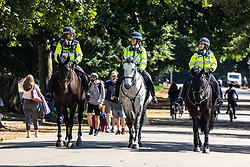 Licensed to London News Pictures. 25/08/202. London, UK. Mounted police enjoy the warm sunshine and highs of 24c in Hyde Park, London today. Weather forecaster predict the mild weather will continue this week with highs of 22c for the Bank Holiday weekend. Photo credit: Alex Lentati/LNP