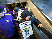 28 FEBRUARY 2020 - MINNEAPOLIS, MINNESOTA: Members of the SEIU Local 26 take an escalator into the main terminal during a strike picket at  the Minneapolis St. Paul International Airport. The striking workers did not disrupt passengers and flights. About 4,000 janitorial and custodial workers represented by the Service Employees International Union (SEIU) Local 26 in the Twin Cities are on an Unfair Labor Practices (ULP) strike for better wages and benefits. Friday morning they picketed  the Minneapolis-St. Paul International Airport Friday morning.         PHOTO BY JACK KURTZ