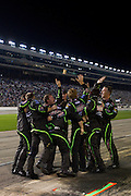 The Interstate Batteries Toyota team celebrates after Kyle Busch (18) crossed the finish line in first place at the Sprint Cup NRA 500 at Texas Motor Speedway in Fort Worth on Saturday, April 13, 2013. (Cooper Neill/The Dallas Morning News)