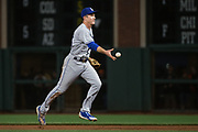Los Angeles Dodgers second baseman Chase Utley (26) flips the ball to first base for an out against the San Francisco Giants at AT&T Park in San Francisco, California, on April 24, 2017. (Stan Olszewski/Special to S.F. Examiner)