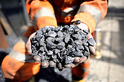 Vernon Watkins, 62, is holding some of the coal extracted from Unity Mine for the first time in 8 years on Tuesday, July 31, 2007, in Cwmgwrach, Vale of Neath, South Wales. The time is ripe again for an unexpected revival of the coal industry in the Vale of Neath due to the increasing prize and diminishing reserves of oil and gas, the uncertainties of renewable energy sources, and the technological advancement in producing energy from coal while limiting emissions of pollutants, has created the basis for valuable investment opportunities and a possible alternative to the latest energy crisis. Unity Mine, in particular, has started a pioneering effort to revive the coal industry in the area, reopening after more than 8 years with the intent of exploiting the large resources still buried underground. Coal could be then answer to both, access to cheaper and paradoxically greener energy and a better and safer choice than nuclear energy as a major supply for the decades to come. It is estimated that coal reserves in Wales amount to over 250 million tonnes, or the equivalent of at least 50 years of energy supply, while the worldwide total coal could last for over 200 years as a viable resource compared to only a few decades of oil and natural gas.