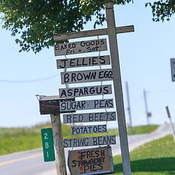 An Amish farm sign offers a variety of items - from fresh strawberry pies to brown eggs - for sale along a Lancaster County Road.