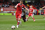 Crawley Town Midfielder Jack Powell (8)  and Bolton Wanderers Forward Oladapo Afolayan (30)  battles for possession during the EFL Sky Bet League 2 match between Crawley Town and Bolton Wanderers at The People's Pension Stadium, Crawley, England on 8 May 2021.
