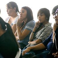 072513  Adron Gardner/Independent<br /> <br /> Guests at the Youth Conference watch multimedia presentations on diabetes, suicide and bullying in Crownpoint Thursday.