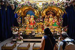 © Licensed to London News Pictures. 02/09/2018. WATFORD, UK.  Devotees attend darshan (prayers) viewing statues of Lord Krishna at the biggest Janmashtami festival outside of India at the Bhaktivedanta Manor Hare Krishna Temple in Watford, Hertfordshire.  The event, which celebrates the birth of Lord Krishna, includes a cultural and spiritual festival at a property donated to the Hare Krishna movement by ex Beatle George Harrison.  Photo credit: Stephen Chung/LNP