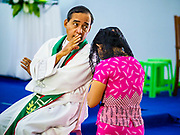 19 NOVEMBER 2017 - HWAMBI, YANGON REGION, MYANMAR: Father NOEL LATT hears a parishioner's confession at Sacred Heart's Catholic Church in Hwambi, about 90 minutes north of Yangon. Catholics in Myanmar are preparing for the visit of Pope Francis. He is coming to the Buddhist majority country November 27-30. There about 500,000 Catholics in Myanmar, about 1% of the population. Catholicism was originally brought to what is now Myanmar more than 500 years ago by Portuguese missionaries and traders.    PHOTO BY JACK KURTZ